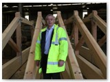 01 Vincent Fay of GEM Purcell beside completed roof trusses in GEM Joinery