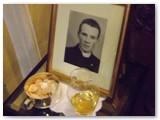 09 Gifts table with a portrait of the young Fr Martin