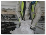 09 The third and final mould for shaping the plasterwork is carved out of wood as held here by the plasterer